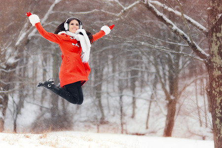 Happy Winter Woman Jumping in the Snow