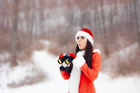 Surprised Girl with Binoculars Looking for Christmas Stock Photo
