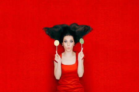 female christmas: Surprised Woman With Lollipops on Red Background