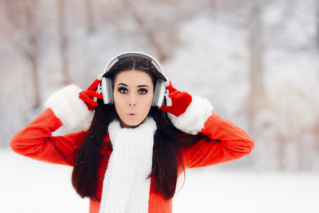 Surprised Winter Woman With Wireless Headphones
