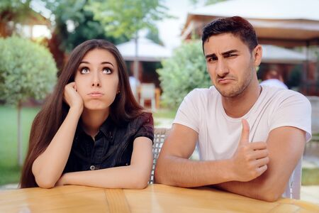 spousal: Woman and Man on a Boring Bad Date at the Restaurant