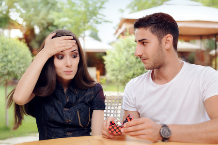 Surprised Woman Receiving Engagement Ring from Man