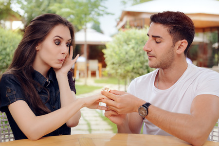 obsessed: Surprised Woman Receiving Engagement Ring from Man