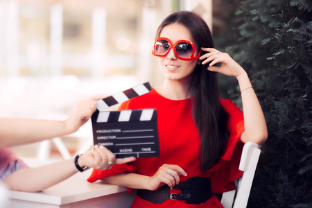 Happy Actress with Oversized Sunglasses Shooting Movie Scene Archivio Fotografico