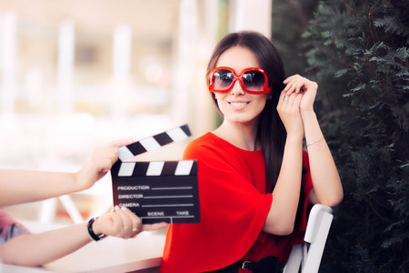 Happy Actress with Oversized Sunglasses Shooting Movie Scene Archivio Fotografico