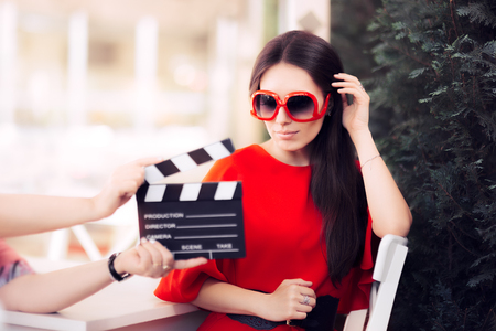Actress with Oversized Sunglasses Shooting Movie Scene Archivio Fotografico
