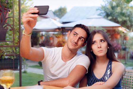 Romantic Couple on a Date at the Restaurant Taking a Selfie Stock Photo