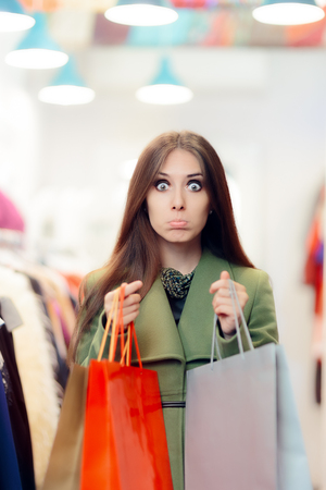 Disappointed  Shopping Woman Wearing a Green Coat in Fashion Store