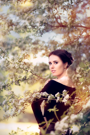 beatitude: Beautiful Graceful Woman in Spring Blossom Enjoying the Flowers Stock Photo