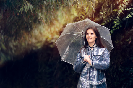 Happy Woman in Raincoat with Transparent Umbrella