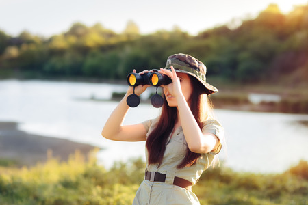 Explorer Girl with Camouflage Hat and Binoculars Stock Photo