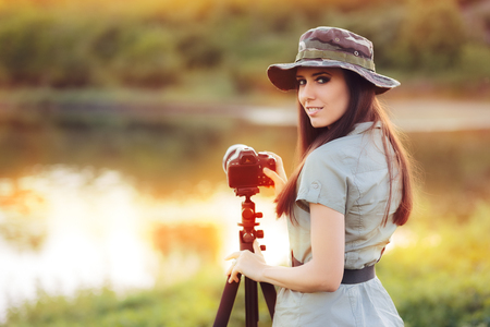 Landscape Photographer with Camera on a Tripod Stock Photo