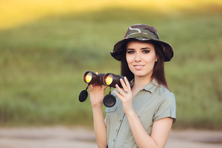 discoverer: Explorer Girl with Camouflage Hat and Binoculars Foto de archivo