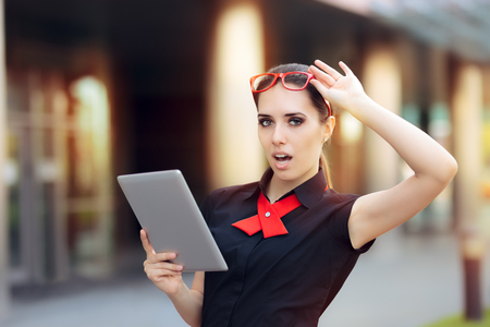Surprised Businesswoman with Pc Tablet and Red Glasses Stock Photo