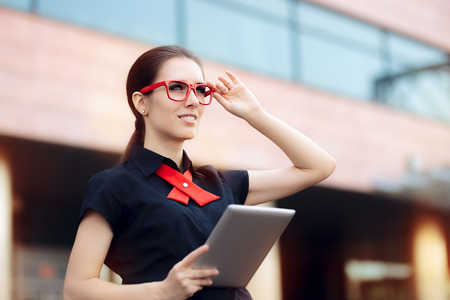 Smiling Businesswoman with Pc Tablet and Red Frame Glasses