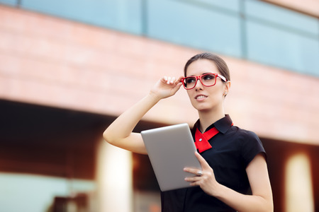 Businesswoman with Pc Tablet and Red Frame Glasses Stock Photo