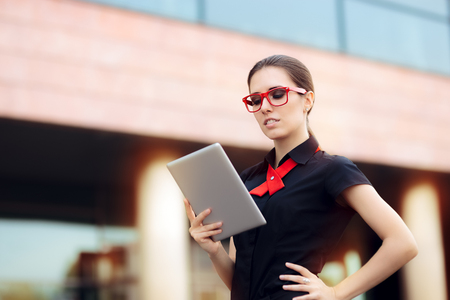 pr: Businesswoman with Pc Tablet and Red Frame Glasses Stock Photo