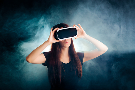 Woman with VR Glasses Headset Enjoying the Virtual Reality Experience