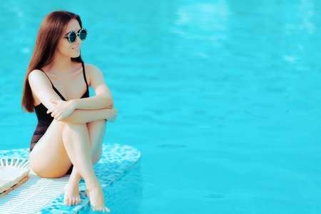 Summer Girl with Fashion Sunglasses and Black Swimsuit by the Pool