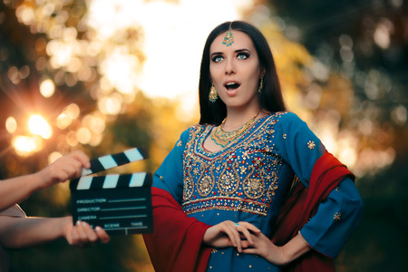 Surprised Bollywood Actress Wearing an Indian Outfit and Jewelry Stock Photo