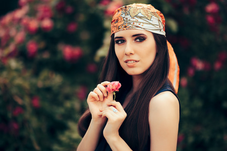 Fashion Woman Wearing Head Scarf in 70's Retro Style Outfit Stock Photo
