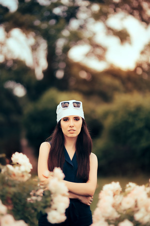 Fashion Woman Wearing Head Scarf and Retro Sunglasses 70�s Style Stock Photo