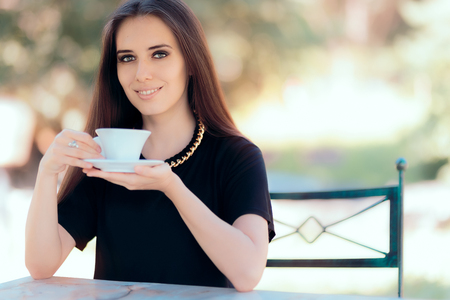 Beautiful Woman with Statement Necklace Having a Cup of Coffee Stock Photo