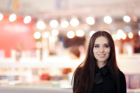 Smiling Elegant Woman Wearing  Black Shirt and Bowtie Standing Indoors Stock Photo - 83683482