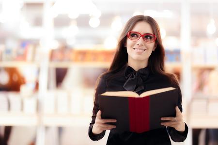 Smiling Girl Wearing Eyeglasses Shopping for Books Stock Photo