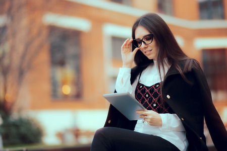 Business Woman with Reading Glasses and Tablet PC Outside