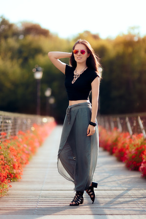Fashionable Woman in Turkish Style Outfit on The Bridge of Desires Stock Photo