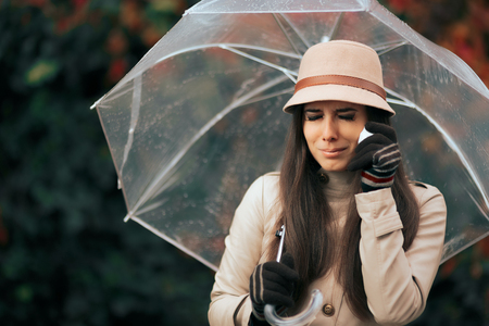 Sad Woman Holding  Umbrella in Autumn Rain Crying
