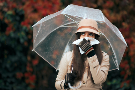 Sick Woman Holding  Umbrella in Autumn Rain Blowing Her Nose