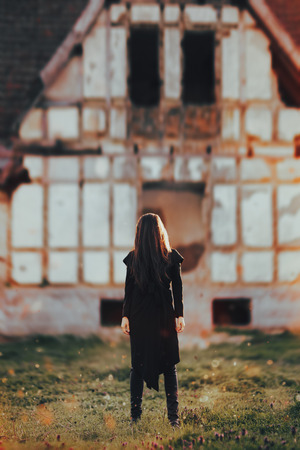 Evil Ghost in Front of a Horror Haunted Abandoned House Stock Photo - 87238135