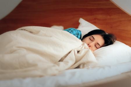 Woman Wearing Pajamas Sleeping in Her Bedroom Stock Photo