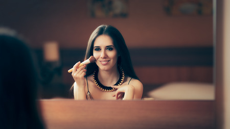 Woman With Makeup Brush Getting Ready for Party