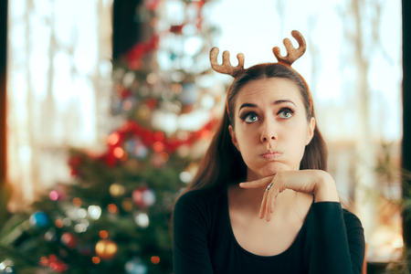 Sad Bored Woman Having No Fun At Christmas Dinner Party 免版税图像