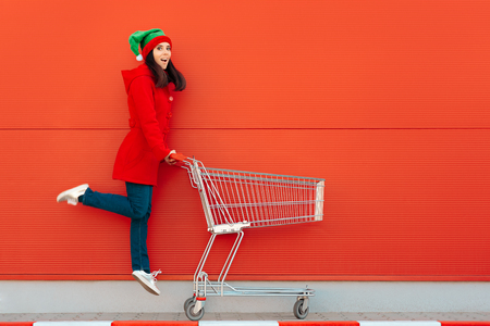 Happy Woman with Shopping Cart Ready for Christmas Sale