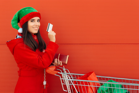 christmas spending: Happy Woman Paying with Card on Her Gift Shopping Spree Stock Photo