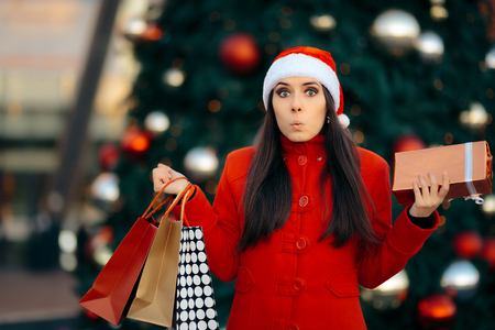 generosa: Christmas Shopping Girl with Bags and Gift Box Foto de archivo