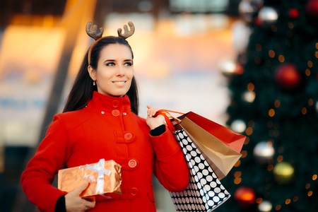 Christmas Shopping Girl with Bags and Gift Box Stock Photo