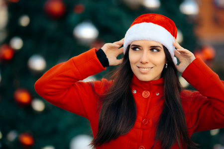 Portrait of a Happy Christmas Girl with Santa Hat Stock Photo