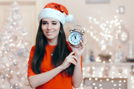 Christmas Woman with Alarm Clock Waiting for Santa Claus