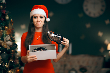 Sad Woman Hating Receiving Flat Shoes as Christmas Present Imagens