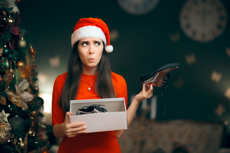 Sad Woman Hating Receiving Flat Shoes as Christmas Present Stockfoto