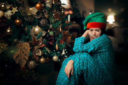 Sad Upset Lonely Girl Crying Next to Her Christmas Tree