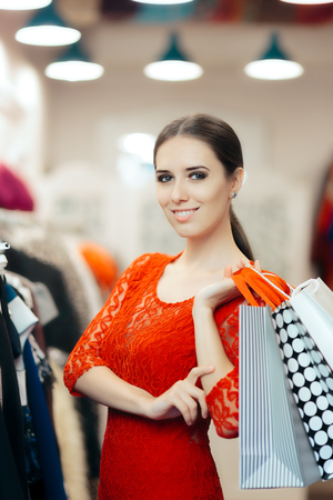 Woman in Red Lace Dress Shopping for Clothes