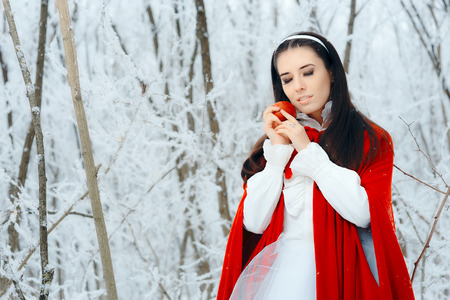Beautiful Snow White Princess in Winter Fairy Tale Wonderland Stock Photo