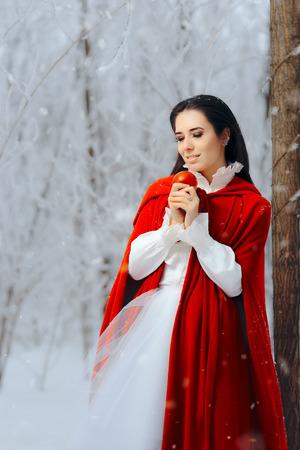 Beautiful Snow White Princess in Winter Fairy Tale Wonderland Stock Photo