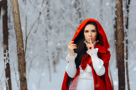 Snow White Princess in Red Cape Keeping a Secret in Winter